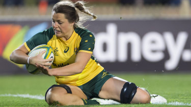 Amazing Grace: Hamilton scores one of her three tries at North Sydney Oval on Friday night.