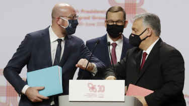 Prime Ministers Mateusz Morawiecki of Poland, centre, Viktor Orban of Hungary, right, with European Council President Charles Michel, left.