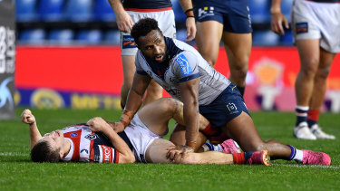 Roosters halfback Sam Walker after getting hit by Storm centre Justin Olam.