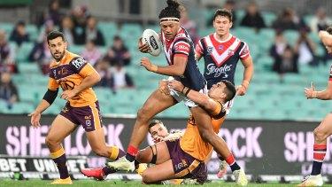 Sitili Tupouniua barges through the Brisbane defence.