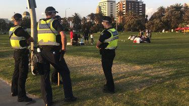 Police patrol St Kilda beach.