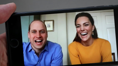Prince William, Duke of Cambridge pictured on April 9, 2020, in a video chat with school students, alongside Catherine, Duchess of Cambridge. Sources say he contracted coronavirus in April.
