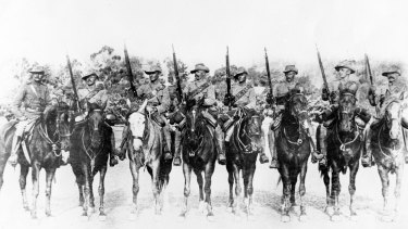 Harry ''Breaker'' Morant, third from left, with members of the South Australian Infantry who left for the South African in February 1900.