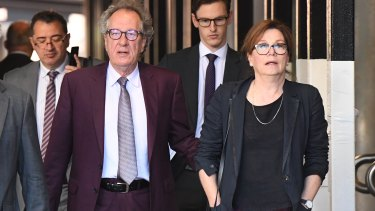 Geoffrey Rush outside court on Tuesday with wife Jane Menelaus.