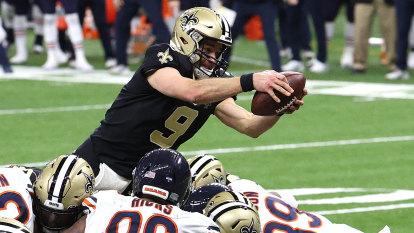 Saints win to set up Brees-Brady showdown, Ravens advance
