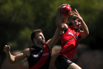 Youngster Archie Perkins goes up against Cale Hooker at training.