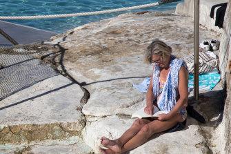 A sunbather enjoys the winter sunshine at Bronte Pool in Sydney on Thursday.