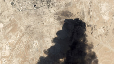 A satellite image shows thick black smoke rising from Saudi Aramco's Abqaiq oil processing facility. Riyadh reports that fires have now been extinguished.