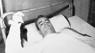 John McCain lies injured in North Vietnam.