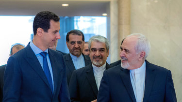 Syrian President Bashar al-Assad, left, speaking with Iranian Foreign Minister Mohammad Javad Zarif, right, in Damascus, Syria, last month.