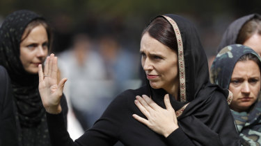 New Zealand Prime Minister Jacinda Ardern waves as she leaves Friday prayers at Hagley Park in Christchurch.