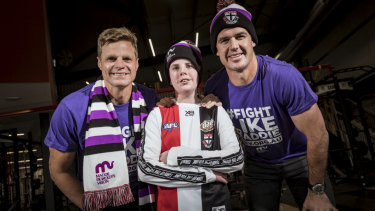 Nick Reiwoldt and Jonathon Brown with Maddie match ambassador Blake Driden, who suffers from aplasatic anemia.