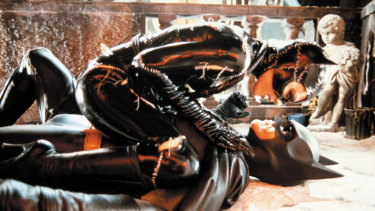 Michelle Pfeiffer as Catwoman and Michael Keaton as Batman in Batman Returns.