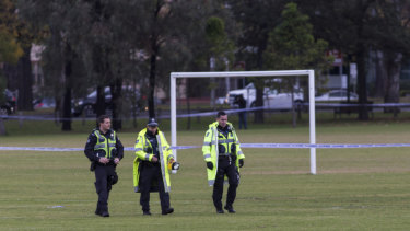 Detectives comb the Princes Park pitch for clues after a woman's body was found.