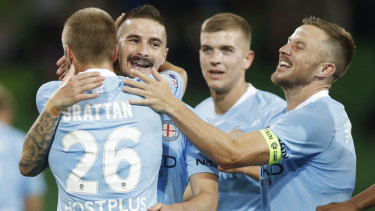 Jamie Maclaren of Melbourne City (second from left) celebrates after scoring a goal.