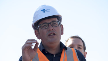 Victorian Premier Daniel Andrews speaks to the media during a visit to a railway level crossing removal site in Murrumbeena, Victoria, in January.