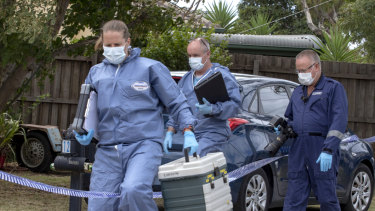 Forensic police arrive at a home in Melbourne's west on Tuesday, after two people were arrested on Monday night.