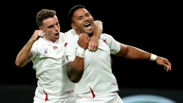 Manu Tuilagi, right, celebrates with teammate George Ford after scoring his second try for England.