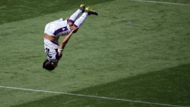 Sam Kerr celebrates her hat-trick with a backflip.