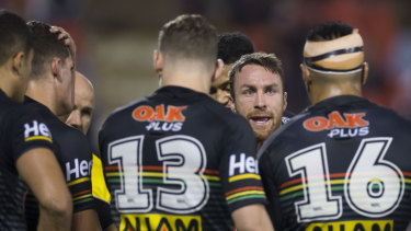 Sticking solid: James Maloney tries to rally the Panthers against the Warriors.