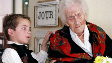 Jeanne Calment in a February 1997 file photo with five-year-old Thomas, who brought her flowers at her retirement home in Arles, France.