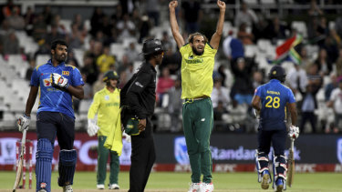 Imran Tahir celebrates South Africa's win after the super over.