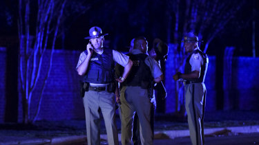 South Carolina state troopers gather near the scene of the incident.