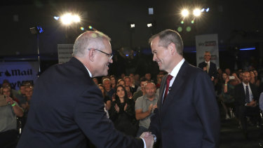 Prime Minister Scott Morrison and Opposition Leader Bill Shorten shake hands before the Brisbane debate.
