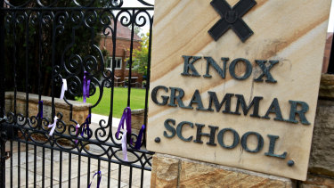 Ribbons on the front gates at Knox Grammar after the royal commission in 2015.