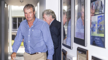 Darren Weir (left) leaving Victorian Racing Club's headquarters in Flemington last week.