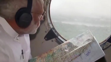 Indian Prime Minister Narendra Modi surveys the flood affected areas in Kerala by plane last weekend.
