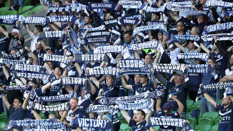 True Blue: Happy Victory fans fly their colours at AAMI Park.