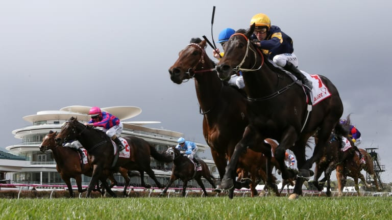 Brutal (right) fights back to win at Flemington.
