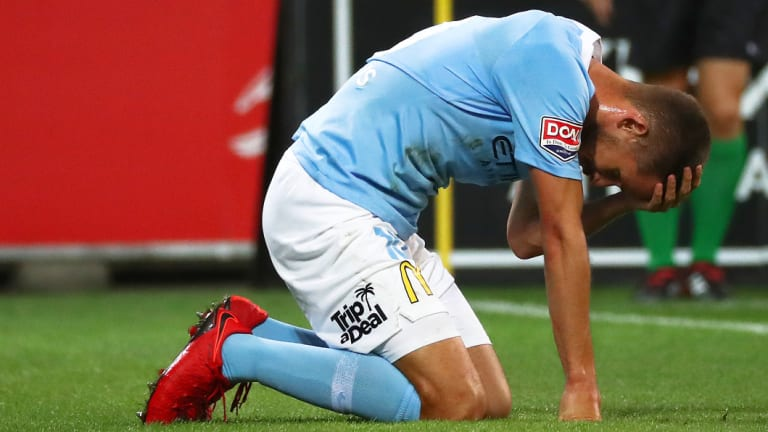 City's Dario Vidosic holds his head during the loss to Sydney FC.