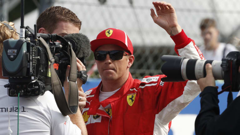 Blistering: Ferrari's Kimi Raikkonen waves at fans after taking pole in qualifying for the Italian Grand Prix.