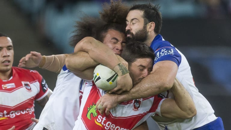 Aarons Woods and Raymond Faitala-Mariner tackle Ben Hunt.