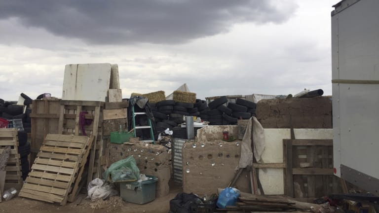 This photo released by Taos County Sheriff's Office shows the rural compound in which they found 11 children in filthy conditions.