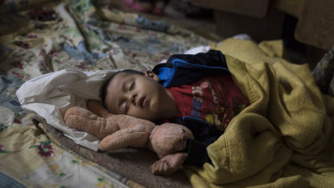 A Central American child who is travelling with a caravan of migrants sleeps at a shelter in Tijuana, Mexico, in April.