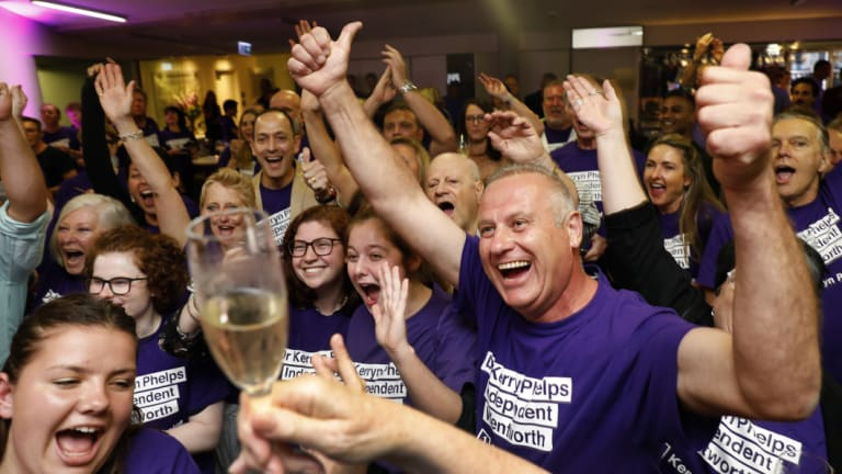 Supporters cheer as the ABC predict a win for Independent candidate Kerryn Phelps during a Wentworth byelection evening function.