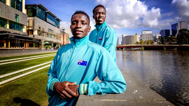 Runners Peter Bol (left) and  Joseph Deng.