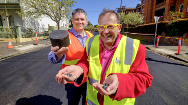 Port Phillip mayor Dick Gross and Fulton Hogan's Peter Curl with plastic used to resurface Mozart Street.