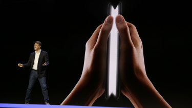 Samsung executive Justin Denison speaks about the Infinity Flex Display at a conference in November.