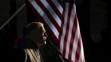 Washington State Governor Jay Inslee speaks to protesters.