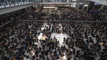 Protesters during a sit-in at the arrival hall of the Hong Kong International airport on Monday.