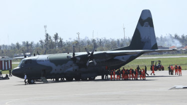 Members of the Brazilian emergency response team arrive at Beira International airport in Mozambique.