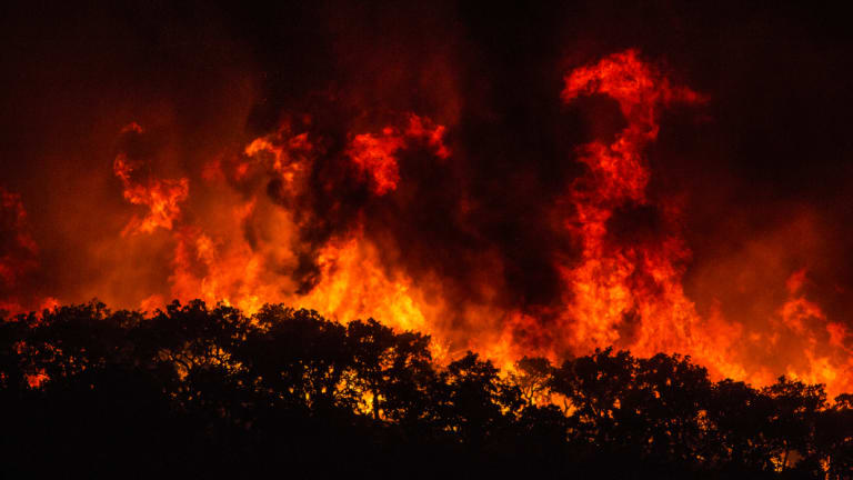 Large flames are seen on a hillside outside the village of Monchique, in southern Portugal's Algarve region, on Sunday.