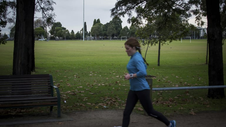 Running past the soccer field at Princes Park.