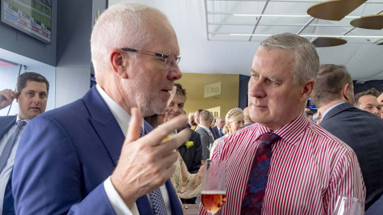 Former ABC chairman Justin Milne and Deputy Prime Minister Michael McCormack chat at the Tabcorp marquee.
