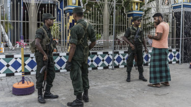 Soldiers stand guard outside the Badhiriy Yah Jum'ah Mosque, in Kattankudy, where Zaharan Hashim worshipped.