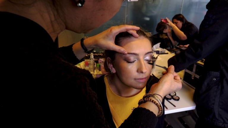 A model has their make-up applied backstage at Access to Fashion.